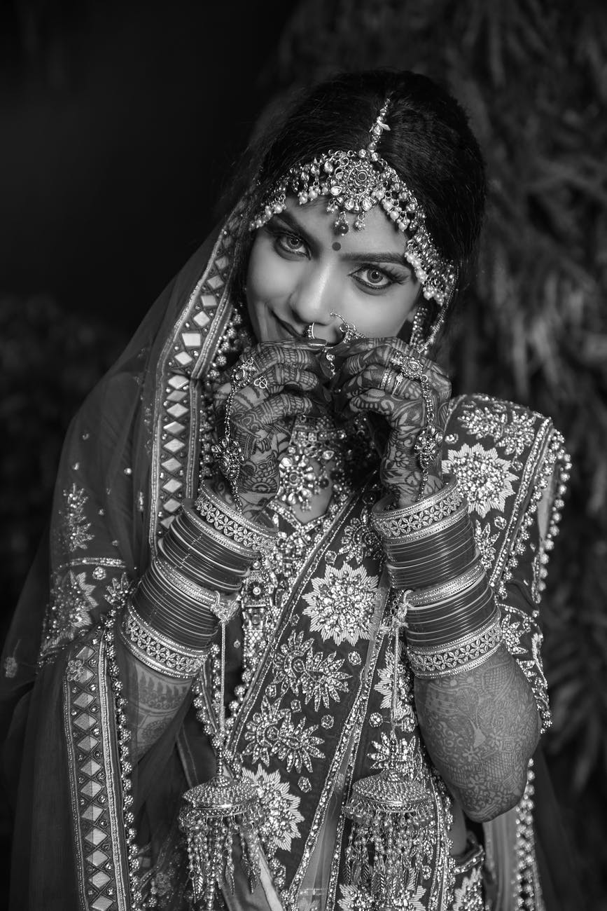 gray scale photo of a bride during night time